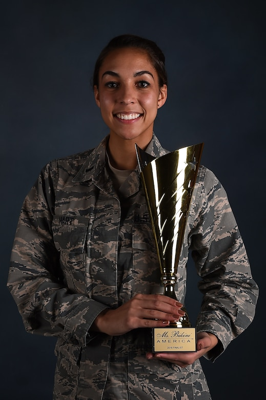 1st Lt. Jamielynn Hart, 2nd Space Warning Squadron deputy flight commander and space operations center commander, stands with her Fitness America fourth place trophy Jan. 11, 2016, on Buckley Air Force Base, Colo. Fitness America, an international fitness competition, in which Hart placed fourth in the 18 to 30, tall bikini competition. (U.S. Air Force photo by Airman 1st Class Gabrielle Spradling/Released)