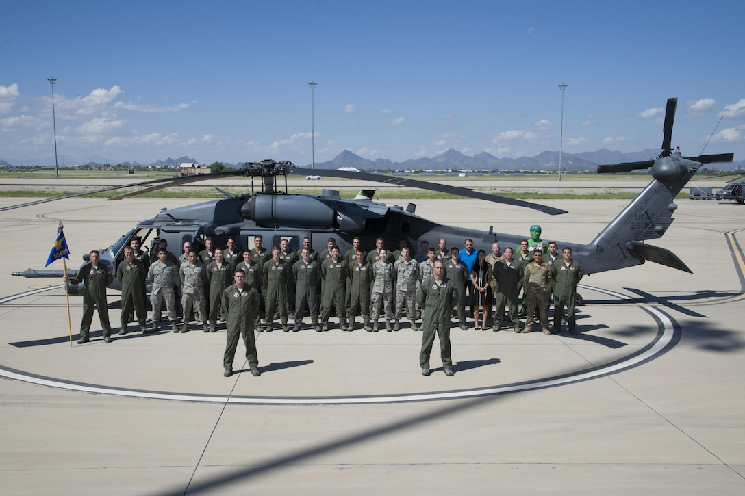 U.S. Airmen form the 55th Rescue Squadron pose for a group photo in front of an HH-60G Pave Hawk at Davis-Monthan Air Force Base, Ariz., Sept. 21, 2016.  The 55th RQS operates out of D-M but falls under the 23d Wing headquartered at Moody AFB, Ga. (U.S. Air Force photo by Senior Airman Betty R. Chevalier)