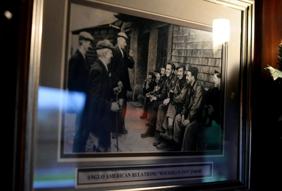 Photos depicting life during World War II adorn the walls of the Woodman Inn, located in Nuthampstead, England. Relationships between locals and American Airmen were often times forged in the Woodman Inn pub. (U.S. Air Force photo by Josh Plueger)
