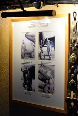 Photos of 55th Fighter Group pilots standing next to their P-38 Lightnings hang on the walls of the Woodman Inn, located in Nuthampstead, England. The décor of the Woodman solely pay tribute to the Airmen that flew the missions from the host air field. (U.S. Air Force photo by Josh Plueger)