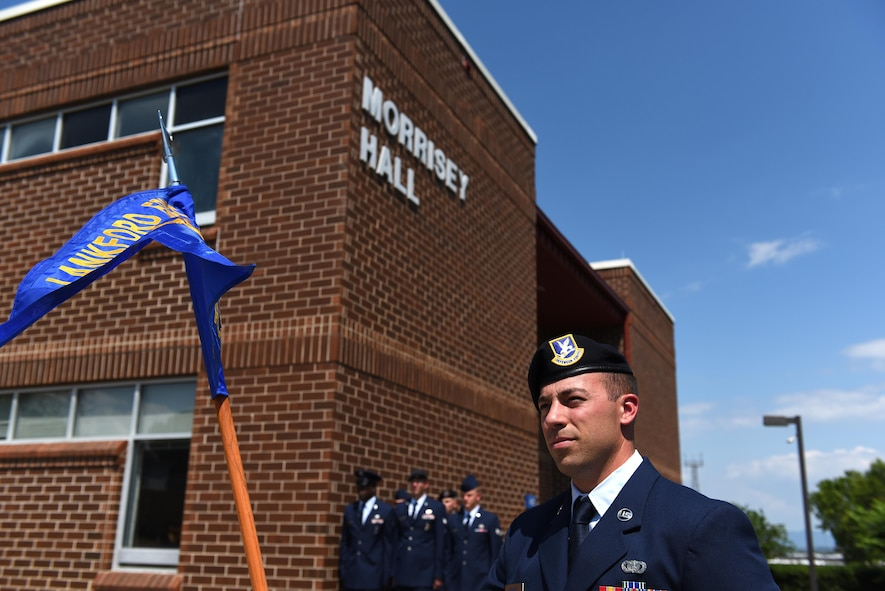 A security forces Airman holds a flight guidon during a retreat ceremony in Airman leadership school at the Chief Master Sergeant Paul H. Lankford Enlisted Professional Military Education Center in Tennessee. ALS students preform reveille and retreat regularly. They are also graded on marching a flight, among other drill and ceremony, as part of their initial EPME studies.  (U.S. Air National Guard photo by Master Sgt. Mike R. Smith)