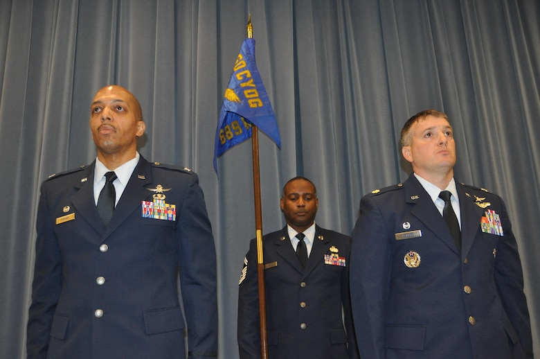 Commander of the 960th Cyberspace Operations Group, Col. Anthony Perkins, left, and Maj. Kevin Deibler, commander of the 689th Networks Operations Squadron, participate in an Assumption of Command ceremony Feb. 12, at Gunter Annex. The 689th is the Air Force's newest Net Ops Squadron in the Cyber fight. (U.S. Air Force photo by Bradley J. Clark)
