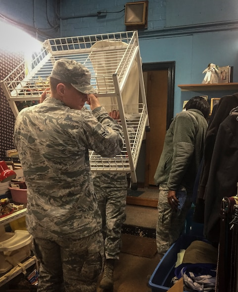 Volunteers from the 70th Intelligence, Surveillance and Reconnaissance Wing help move items during the Meade Attic relocation in late 2016 at Fort George G. Meade, Md. Earlier this year, the Meade Attic, which is operated strictly by volunteers, moved its location to 392 Llewellyn Ave., Fort Meade, Md., 20755, which is next to the Thrift Shop. (Courtesy photo)