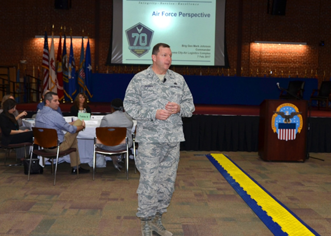 Air Force Brig. Gen. (select) Mark Johnson, commander, Oklahoma City-Air Logistics Complex at Tinker Air Force Base, Oklahoma, speaks to Defense Logistics Agency Aviation's leadership and strategic partners, from an Air Force customer's perspective, at the annual Senior Leadership Conference, Feb. 7, 2017, on Defense Supply Center Richmond, Virginia.