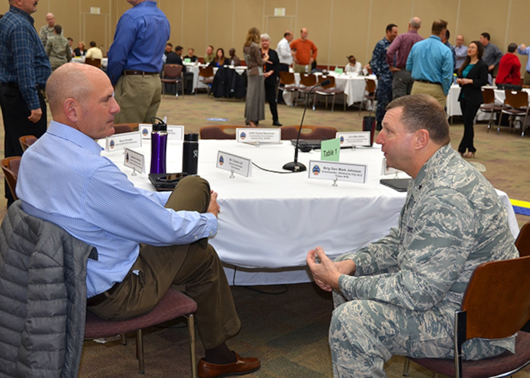 Former Defense Logistics Agency Aviation Commander Air Force Brig. Gen. (select) Mark Johnson, current commander of the Oklahoma City-Air Logistics Complex at Tinker Air Force Base, Oklahoma, and DLA Aviation's Deputy Commander Charlie Lilli have a discussion during a break at the annual Senior Leadership Conference, Feb. 7, 2017, on Defense Supply Center Richmond, Virginia. The conference was held from Feb. 7-9. Johnson spoke to DLA Aviation's leadership and strategic partners, from an Air Force customer's perspective.