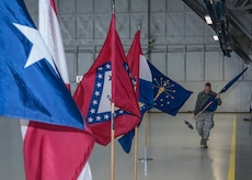 Senior Airman Matthew Beaton, 11th Civil Engineer Squadron engineering journeyman, arranges U.S. state flags in a hangar at Joint Base Andrews, Md., Feb. 16, 2017. Airmen like Beaton worked over the span of a morning, transforming a hangar into a decorated location for the Chief Master Sergeant of the Air Force Transition Ceremony, scheduled for Feb. 17. (U.S. Air Force photo by Senior Airmen Jordyn Fetter)