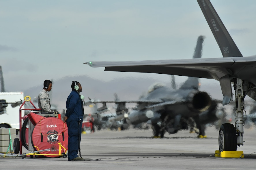 Crew chiefs from Hill Air Force Base, Utah, prepare to launch F-35A aircraft Feb. 7 at Nellis Air Force Base, Nevada, during Red Flag 17-1. (U.S. Air Force photo by R. Nial Bradshaw)