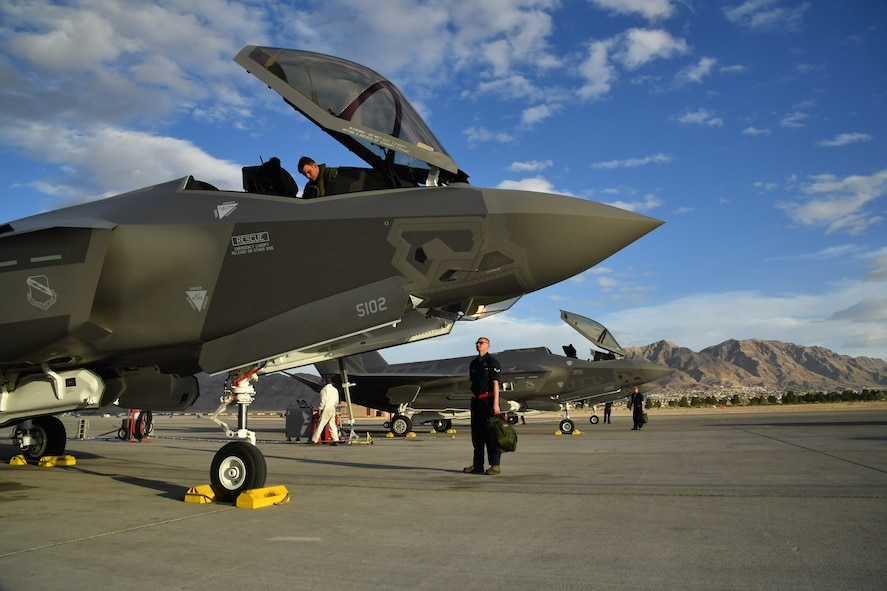 An F-35A pilot and crew chief from Hill Air Force Base, Utah, prepare for a sortie Feb. 7 at Nellis Air Force Base, Nevada, during Red Flag 17-1. (U.S. Air Force photo by R. Nial Bradshaw)