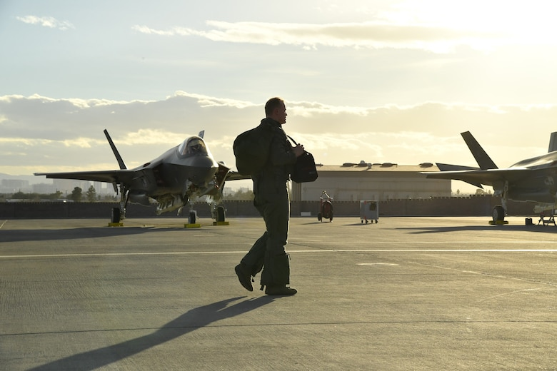 An F-35A aircraft pilot from Hill Air Force Base, Utah, walks away from his jet after a sortie Feb. 7 during Red Flag 17-1 at Nellis Air Force Base, Nevada. (U.S. Air Force photo by R. Nial Bradshaw)