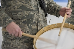U.S. Air Force Band percussionist beats on a drum during the Chief Master Sergeant of the Air Force Transition Ceremony rehearsal at Joint Base Andrews, Md., Feb. 16, 2017. The Band, U.S. Air Force Honor Guard and base members are scheduled to attend the ceremony, February 17. (U.S. Air Force photo by Airman 1st Class Valentina Lopez)