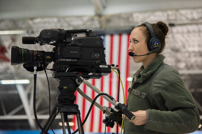 Staff Sgt. Elisa Juhas, U.S. Air Force TV broadcast producer, documents the Chief Master Sergeant of the Air Force Transition Ceremony rehearsal at Joint Base Andrews, Md., Feb. 16, 2017. Chief Master Sergeant of the Air Force James A. Cody is scheduled to retire, February 17, after serving 32 years in the Air Force and the 18th Chief Master Sergeant of the Air Force Kaleth O. Wright is planned to be appointed. (U.S. Air Force photo by Airman 1st Class Valentina Lopez)