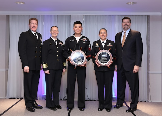 Naval Sea Systems Command (NAVSEA) Master Chief Russ Mason, NAVSEA Chief of Staff Capt. Renee Squier and NAVSEA Executive Director Jim Smerchansky pose with the 2016 NAVSEA Sailor of the Year winners: Electrician's Mate 1st Class Disi Zhao (USN) and Master-at-Arms 1st Class Selene Ceballo (USNR).