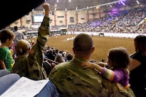 Soldiers watch the mutton busting during the 85th Annual San Angelo Stock Show and Rodeo Military Appreciation Night at the Foster Communications Coliseum in San Angelo, Texas, Feb. 15, 2017. Mutton busting is a rodeo event where children ride bucking sheep. (U.S. Air Force photo by Staff Sgt. Joshua Edwards/Released)