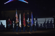 "The Goodfellow Air Force Base Joint-Service Color Guard present the colors during the 85th Annual San Angelo Stock Show and Rodeo Military Appreciation Night at the Foster Communications Coliseum in San Angelo, Texas, Feb. 15, 2017. Goodfellow Air Force Base's Patriotic Blue sang ""The Star-Spangled Banner"" during the presentation of the colors. (U.S. Air Force photo by Staff Sgt. Laura R. McFarlane/Released)"