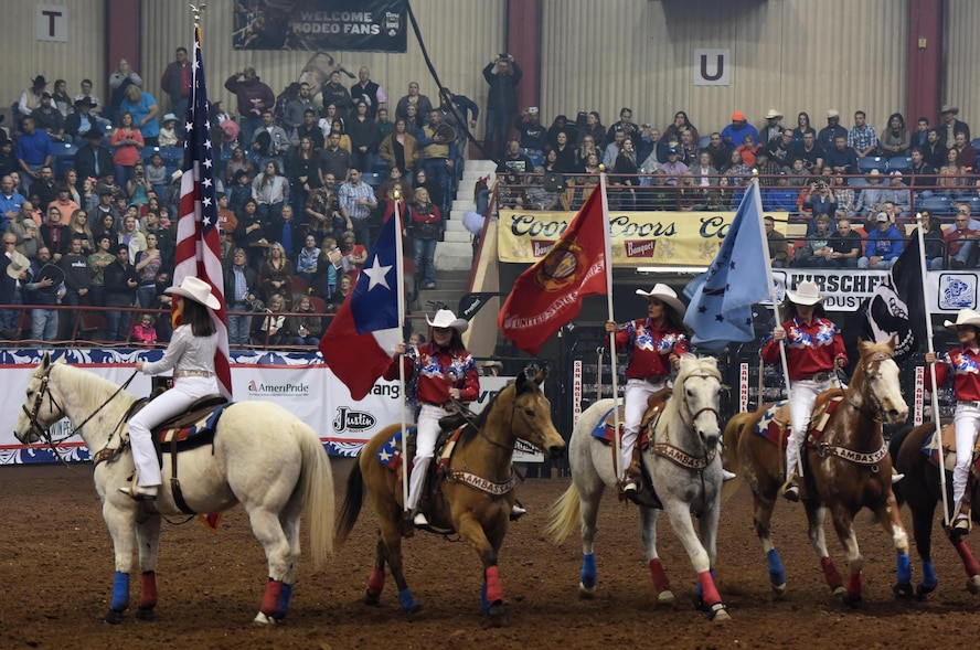 The San Angelo Stock Show and Rodeo Ambassadors Drill Team perform during the 85th Annual San Angelo Stock Show and Rodeo Military Appreciation Night at the Foster Communications Coliseum in San Angelo, Texas, Feb. 15, 2017. They carried patriotic flags during the drill. (U.S. Air Force photo by Staff Sgt. Laura R. McFarlane/Released)