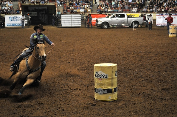 Jackie Ganter, San Angelo Stock Show and Rodeo barrel racing competitor, goes around for the last barrel during the 85th Annual San Angelo Stock Show and Rodeo Military Appreciation Night at the Foster Communications Coliseum in San Angelo, Texas, Feb. 15, 2017. Besides barrel racing, the rodeo featured calf roping and bareback horse riding. (U.S. Air Force photo by Staff Sgt. Laura R. McFarlane/Released)