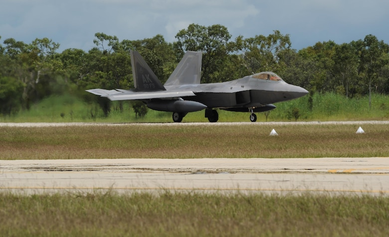 A U.S. Air Force F-22 Raptor assigned to the 90th Fighter Squadron, Joint Base Elmendorf-Richardson, Alaska, lands at Royal Australian Air Force (RAAF) Base Tindal, Feb. 13, 2017. Twelve F-22 Raptors and approximately 200 Airmen are at RAAF Base Tindal as part of the Enhanced Air Cooperation (EAC) Initiative under the Force Posture Agreement between the U.S. and Australia. EAC creates the foundation for an enhanced rotational presence of U.S. military personnel in Australia to promote interoperability, build upon our already strong alliance, and reaffirm our commitment to the Indo-Asia-Pacific region. (U.S. Air Force photo/Staff Sgt. Alexander Martinez)