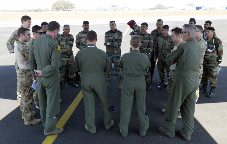 U.S. Air Force and Indian Army members receive a crew brief prior to boarding a C-130J Super Hercules assigned to the 143rd Airlift Wing, Rhode Island Air National Guard, for a joint free-fall jump during Aero India 2017 at Air Force Station Yelahanka, Bengaluru, India, Feb. 16, 2017. Jumpers from the two countries shared best practices and combined into jump teams, to the delight of the crowd. The U.S. participates in air shows and other regional events to demonstrate its commitment to the security of the Indo-Asia-Pacific region, promote the standardization and interoperability of equipment, and display capabilities critical to the success of current and future military operations. (U.S. Air Force photo by Capt. Mark Lazane)