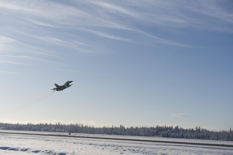 A U.S. Air Force F-16 Fighting Falcon aircraft assigned to the 18th Aggressor Squadron, takes off from the Eielson Air Force Base, Alaska, flight line Feb. 12, 2017. Members of the 18th AGRS began their journey to Andersen Air Force Base, Guam, in support of COPE NORTH 2017 which is an exercise that prepares U.S. and coalition forces for possible contingency operations. (U.S. Air Force photo by Airman Isaac Johnson)