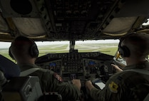 U.S. Air Force Capts. Ryan Nivan (left) and Ben Chase (right), 909th Air Fueling Squadron pilots, prepare to land a KC-135 Stratotanker on the flightline of Andersen Air Force Base, Guam after providing in-flight fuel to multiple aircraft during Cope North 2017, Feb. 16, 2017. The exercise includes 22 total flying units and more than 1,700 personnel from three countries and continues the growth of strong, interoperable relationships within the Indo-Asia-Pacific region through integration of airborne and land-based command and control assets. (U.S. Air Force photo by Senior Airman Keith James)