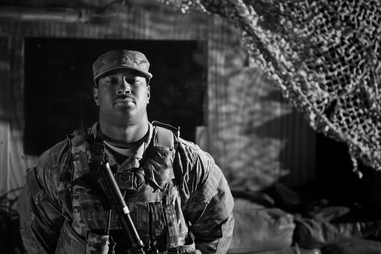 Staff Sgt. Antwan Menzie, Detachment 1 Security Forces, poses for a photo at an entry control point on Al Asad Air Base, Iraq, Feb. 13, 2017. Menzie is part of team, which includes 10 Airmen forward deployed from the 407th Air Expeditionary Group, which created restricted areas on the flightline of the base to protect U.S. Air Force assets.  (U.S. Air Force photo/Master Sgt. Benjamin Wilson)(Released)