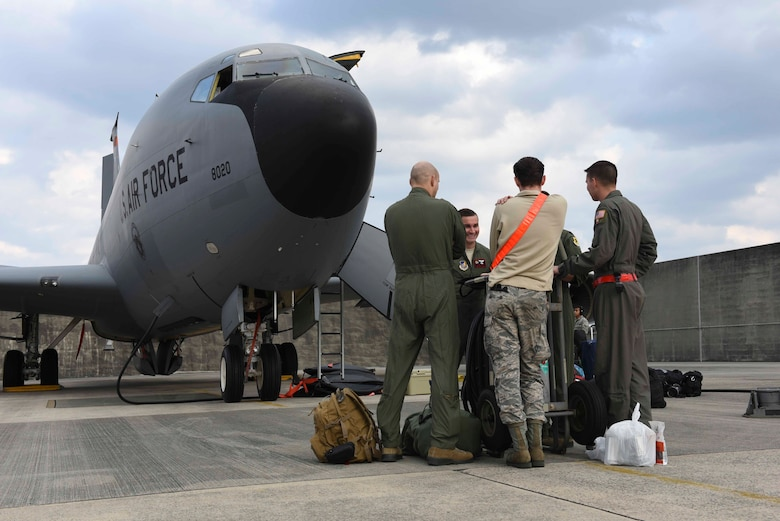 An aircrew from the 909th Air Refueling Squadron discuss pre-flight details Feb. 13, 2017, at Kadena Air Base, Japan. KC-135 Stratotankers from Kadena flew to Anderson Air Force Base, Guam, to participate in the 88th iteration of Cope North, an annual exercise that enables regional forces to train together to enhance readiness and war-fighting integration. (U.S. Air Force photo by SrA John Linzmeier)