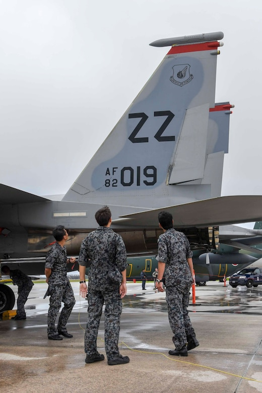 Japan Air Self-Defense Force Airmen observe an F-15 Eagle from the 67th Fighter Squadron Feb. 15, 2017, at Anderson Air Base, Guam. Members from the U.S. Military, JASDF, and Royal Australian Air Force had the opportunity to view their counterpart's aircraft up close during the first day of exercise Cope North 17. (U.S. Air Force photo by SrA John Linzmeier)
