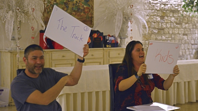 """One couple answers the question, """"Of all the things you've spent money on as a couple, what made you the happiest?"""" during a game at a """"Forever For Real"""" event in Polcenigo, Italy, February 11, 2017. The event, hosted by the base chapel and Airman and Family Readiness Center, consisted of a five-course meal and an interactive discussion about finances. (U.S. Air Force photo by Senior Airman Cary Smith)"""