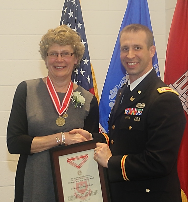 Dr. Jackie Richter-Menge was recently awarded the U.S. Army Engineer Association's Bronze Order of the de Fleury Medal by Army Captain Joseph Marut during her retirement ceremony at the U.S. Army Engineer Research and Development Center's Cold Regions Research and Engineering Laboratory.