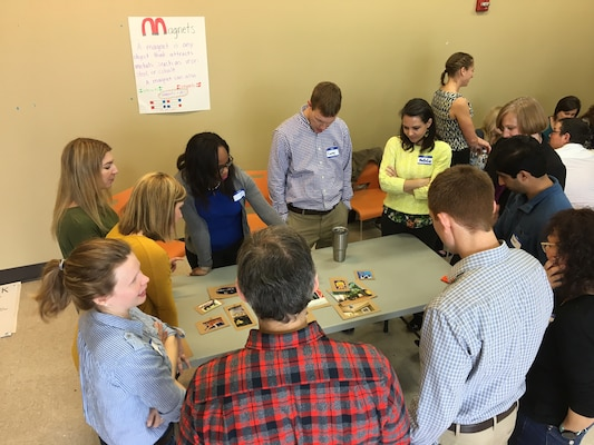 """ERDC ELG team members participate in the """"Telling a Story"""" exercise.  Members of each team arrange their photographs to tell a story."""