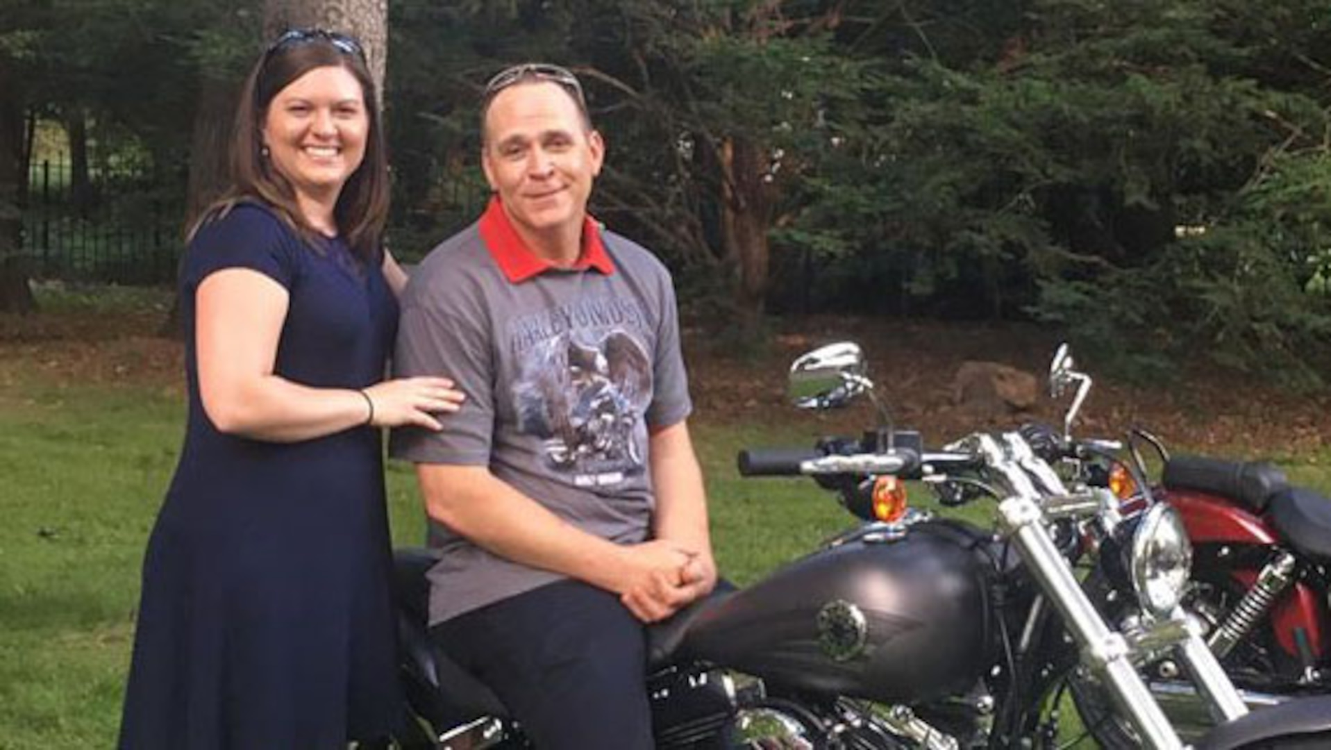 John Bryant, a quality assurance specialist with Defense Contract Management Agency International in Ottawa, Canada, is presented with a Harley Davidson Breakout from his wife, July 4, 2016. The motorcycle was a gift in celebration of his successful battle against cancer. (Photo courtesy of Patrick Norton)
