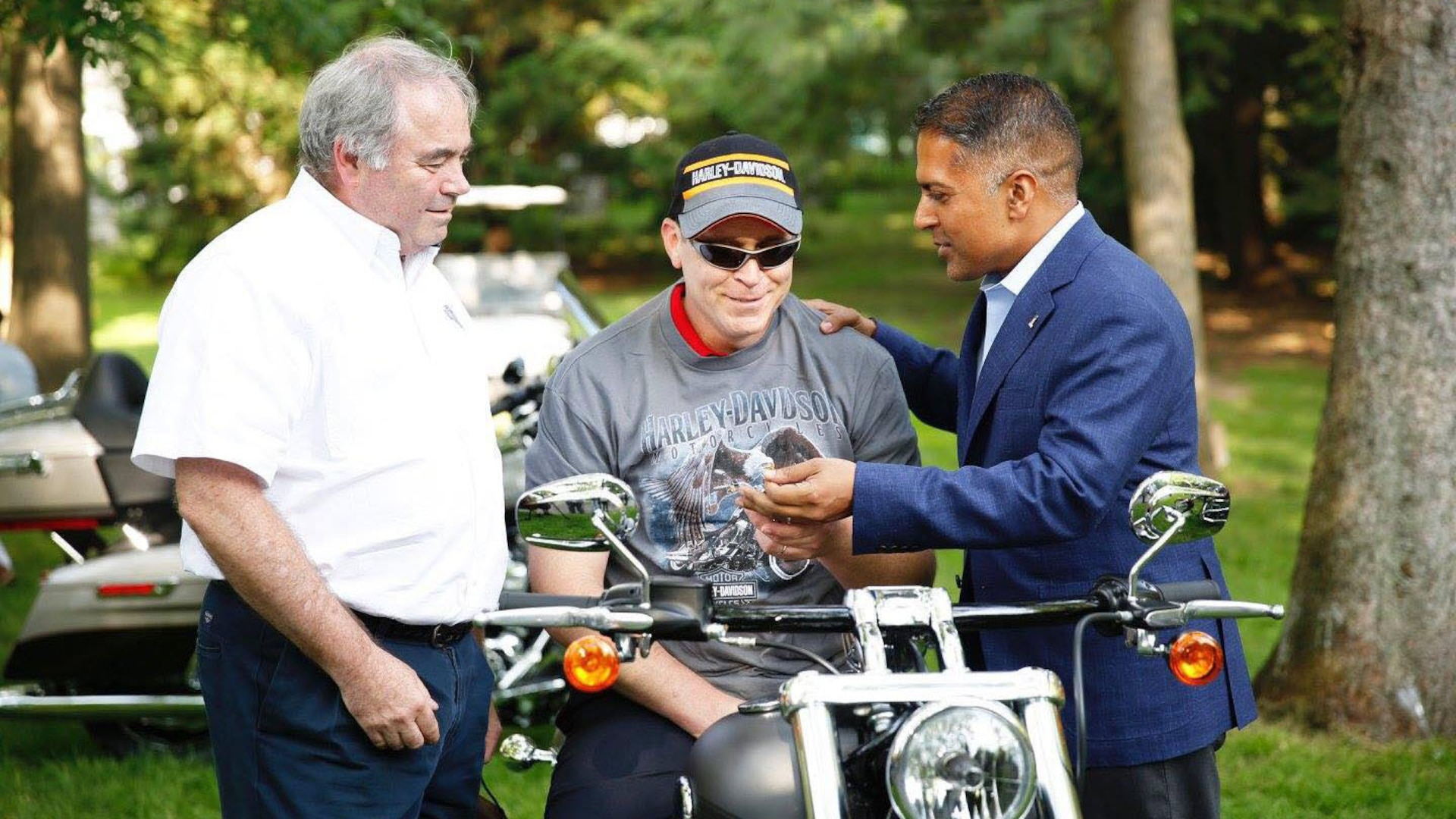 John Bryant, a quality assurance specialist with Defense Contract Management Agency International in Ottawa, Canada, is presented the keys to a Harley Davidson Breakout by Lynn Norton, left, dealer principal for Freedom Harley Davidson, Ottawa and Anoop Prakas, managing director for Harley Davidson Canada, July 4, 2016. The motorcycle was a gift from his wife after a successful battle against cancer. (Photo courtesy of Patrick Norton)