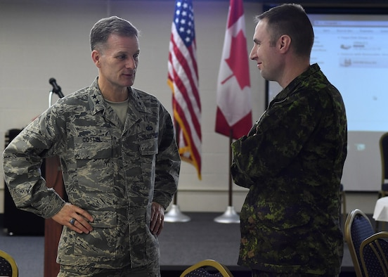 Maj. Gen. Dondi E. Costin, U.S Air Force Chief of Chaplains, left, speaks with Canadian armed forces member Capt. Jeff Reinink, 10th Space Warning Squadron crew commander, Feb. 16, 2017, on Cavalier Air Force Station, North Dakota. Costin became the first Air Force Chief of Chaplains to visit Cavalier AFS. (U.S. Air Force photo by Senior Airman Ryan Sparks)