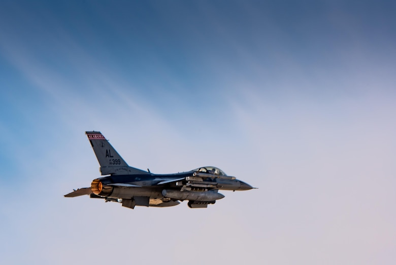 An F-16 from the Alabama Air National Guard flies a mission with the 134th Expeditionary Fighter Squadron in support of Operation Inherent Resolve at the 407th Air Expeditionary Group Dec. 13, 2016. The red tail flash of the jet brings the Tuskegee Airmen's legacy back the 332nd Air Expeditionary Wing, to which the 134th EFS is currently assigned.  (U.S. Air Force photo/Master Sgt. Benjamin Wilson)(Released)
