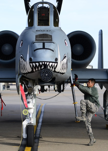 U.S. Air Force Senior Airman Alonso Gudino, a crew chief assigned to the 358th Fighter Squadron, climbs up an A-10 Thunderbolt II aircraft during pre-flight checks prior to a local flying mission at Whiteman Air Force Base, Mo., Feb. 14, 2017. The Thunderbolt II can employ a wide variety of conventional munitions, including general purpose bombs, cluster bomb units, laser guided bombs, joint direct attack munitions (JDAM), wind corrected munitions dispenser (WCMD), AGM-65 Maverick and AIM-9 Sidewinder missiles, rockets, illumination flares, and the GAU-8/A 30mm cannon, capable of firing 3,900 rounds per minute to defeat a wide variety of targets including tanks.