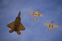 An F-22 Raptor performs a heritage flight during the 2017 Heritage Flight Training Course at Davis-Monthan Air Force Base, Ariz., Feb. 9, 2017. The program was established in 1997, allowing certified civilian pilots and Air Force pilots to perform flights together. (U.S. Air Force photo/Senior Airman Kimberly Nagle)