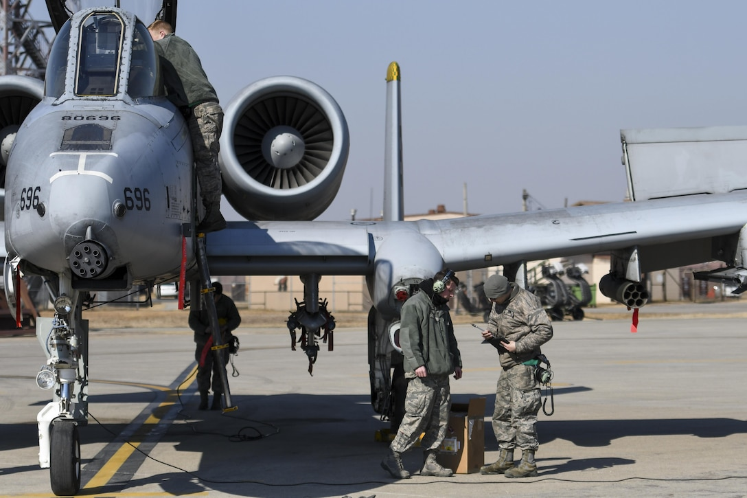 Airmen assigned to the 25th Aircraft Maintenance Unit perform preflight checks on an A-10 Thunderbolt II assigned to the 25th Fighter Squadron during Buddy Wing 17-3 at Osan Air Base, South Korea, Feb. 14, 2017. During Buddy Wing 17-3, pilots from the 25th FS and the South Korean air force's 237th Tactical Control Squadron flew training missions to better interoperability in a wartime scenario. (U.S. Air Force photo/Staff Sgt. Victor J. Caputo)