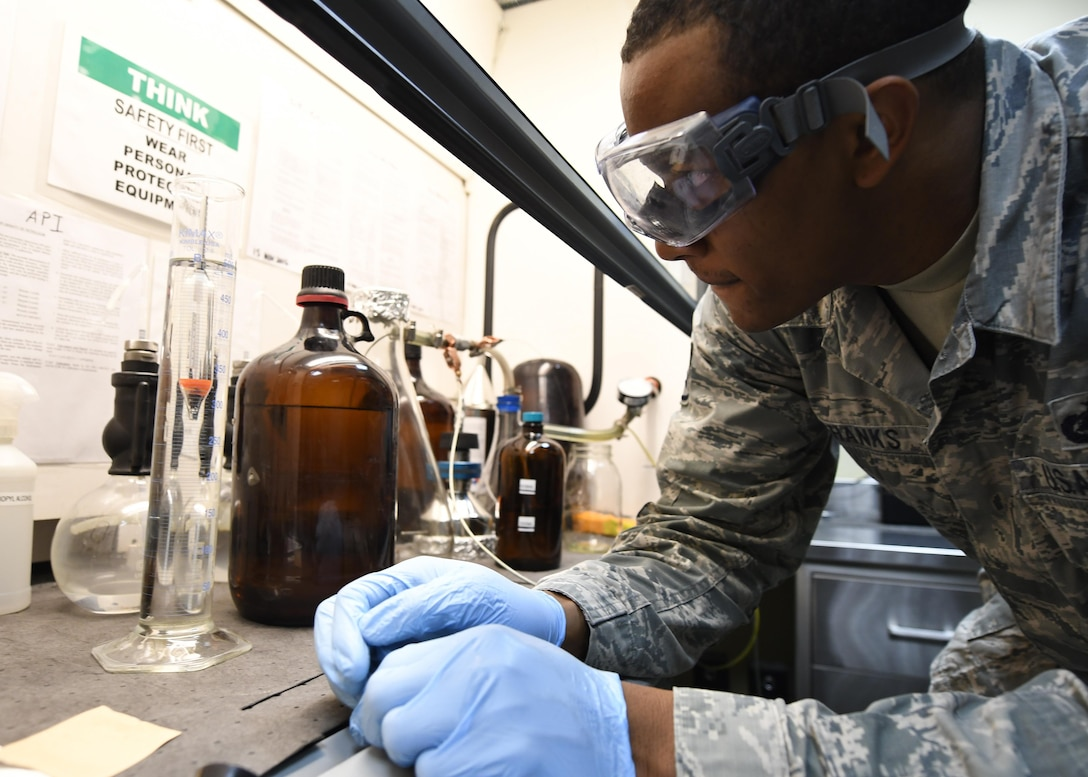 Staff Sgt. Mario Shanks, the 379th Expeditionary Logistics Readiness Squadron fuels laboratory NCO in charge, checks fuel density with a hydrometer at Al Udeid Air Base, Qatar, Feb. 14, 2017. Shanks conducted an American Petroleum Institute specific gravity test on a sample of fuel to determine the density of the fuel which helps them track how much is used. (U.S. Air Force photo/Senior Airman Miles Wilson)