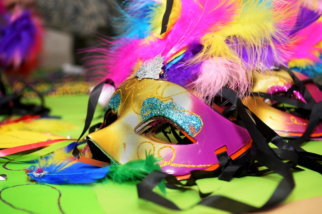 """A mask sits on the table during the Hearts Apart event Feb. 16, 2017, on RAF Mildenhall, England. This month's Hearts Apart event was a """"Mardi Gras"""" theme, including a photo booth complete with props. (U.S. Air Force photo by Airman 1st Class Tenley Long)"""