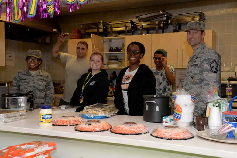 Volunteers from Team Mildenhall pose for a photograph during the Hearts Apart event Feb. 16, 2017, on RAF Mildenhall, England.  The monthly Hearts Apart dinners are a way for spouses and family members of deployed Airmen to gather together and connect.  (U.S. Air Force photo by Airman 1st Class Tenley Long)