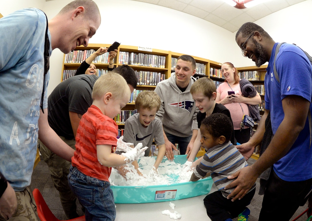 Children with special needs, their siblings and parents, and volunteers make homemade snow during a STEM event Feb. 15, 2016 at the Hill Air Force Base, Utah. The event, coordinated by the base library and Exceptional Family Member Program-Family Support Specialist, featured visual- and texture-based activities. (U.S. Air Force photo by Todd Cromar)