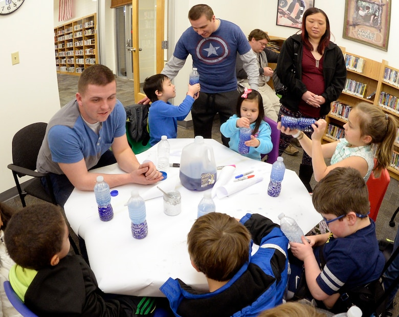 Children with special needs, their siblings and parents, and volunteers make anti-gravity galaxies in bottles during a STEM event Feb. 15, 2016 at the Hill Air Force Base, Utah. The library conducts STEM events most months of the year, generally every third Wednesday. For information on library programs, call 801-777-2533. (U.S. Air Force photo by Todd Cromar)