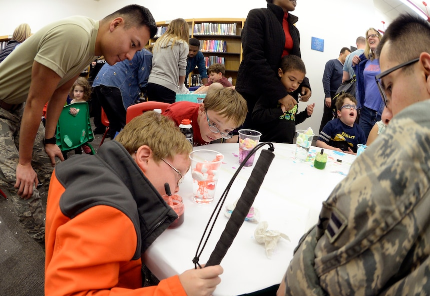 Children with special needs, their siblings and parents, and volunteers make rain clouds out of shaving cream during a STEM event Feb. 15, 2016 at the Hill Air Force Base, Utah. The library setting provided a stress-free environment for the children and their families to have new experiences, just like those enjoyed by typical children. (U.S. Air Force photo by Todd Cromar)