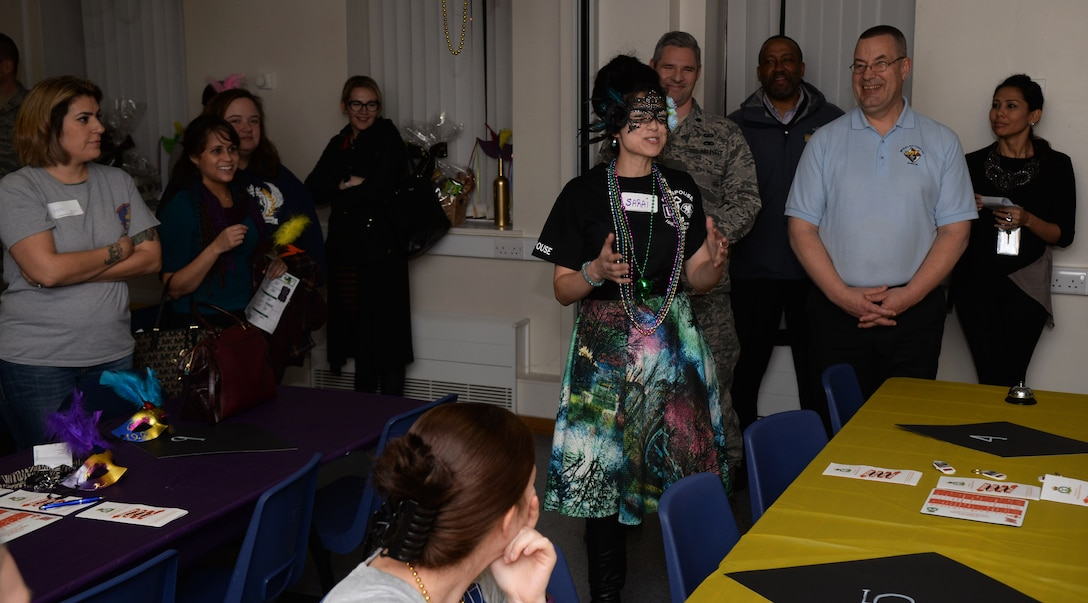 Sarai Boyd, center, Team Mildenhall Key Spouse and wife of U.S. Air Force Lt. Col. Christopher Boyd, 100th Comptroller Squadron commander, welcomes those in attendance at the Hearts Apart event Feb. 16, 2017, on RAF Mildenhall, England. The 100th Wing Staff Agency and 100th CPTS hosted this month's Hearts Apart event. (U.S. Air Force photo by Airman 1st Class Tenley Long)
