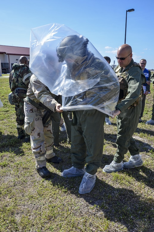 Citizen Airmen with the 920th Rescue Wing work together to decontaminate aircrew members processing through the aircrew contamination control area during the wing's Mission Assurance Exercise Feb. 12 at Patrick Air Force Base, Fla. (U.S. Air Force photo/Senior Airman Brandon Kalloo Sanes)