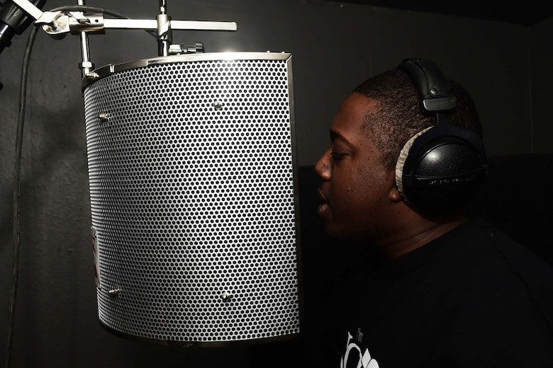 "Staff Sgt. Stanley ""Tyrone"" Crawford, 460th Space Communications Squadron client systems technician, performs one of his own songs inside his studio Nov. 21, 2016, at his home in Aurora, Colo. Crawford began writing rap lyrics at the age of 11, but due to a life-changing event, has changed the direction of his career in order to spread the word of Christ. (U.S. Air Force photo by Airman Holden. S. Faul/Released)"