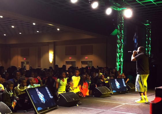 "Staff Sgt. Stanley ""Tyrone"" Crawford, 460th Space Communications Squadron client systems technician, performs for a live audience Nov. 25, 2016, in Orlando, Fla. Crawford began writing rap lyrics at the age of 11, but due to a life-changing event, has changed the direction of his career in order to spread the word of Christ. (Courtesy photo)"