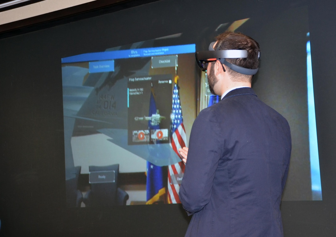 Dr. John Wertz, a materials research scientist in the Materials State Awareness Branch, Materials and Manufacturing Directorate, Air Force Research Laboratory, demonstrates Digital Thread concept applications to aircraft maintenance activities. Real time aircraft data, checklists and feedback through Digital Thread capabilities can enable better decision making by warfighters on the field, enhancing life cycle sustainment of Air Force platforms.  (U.S. Air Force photo / Marisa Alia-Novobilski)