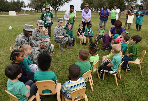 Col. Michele Edmondson, 81st Training Wing commander, and Chief Master Sgt. Vegas Clark, 81st TRW command chief, speak to children from the child development center at an Arbor Day celebration outside of the CDC Feb. 14, 2017, on Keesler Air Force Base, Miss. Keesler AFB earned the national Tree City USA honor from the Arbor Day Foundation for its 24th consecutive year. (U.S. Air Force photo by Kemberly Groue)