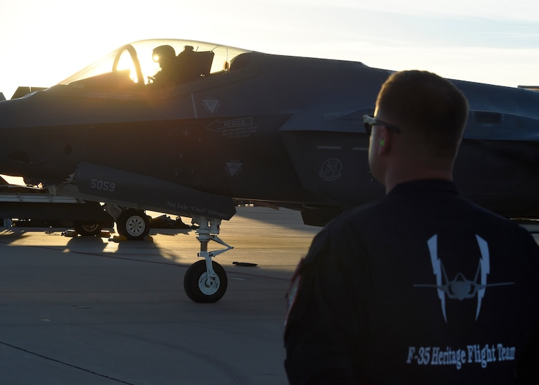 Senior Master Sgt. Sam Smith, 61st Fighter Squadron F-35 heritage flight superintendent, stands by for Maj. Will Andreotta, 61st FS heritage flight pilot, to get out of his jet after flying during the Heritage Flight Training and Certification Course Feb. 10, 2017, at Davis-Monthan Air Force Base, Ariz. Heritage and demonstration teams need to be certified annually to participate in open houses and air shows worldwide. (U.S. Air Force photo by Senior Airman James Hensley)